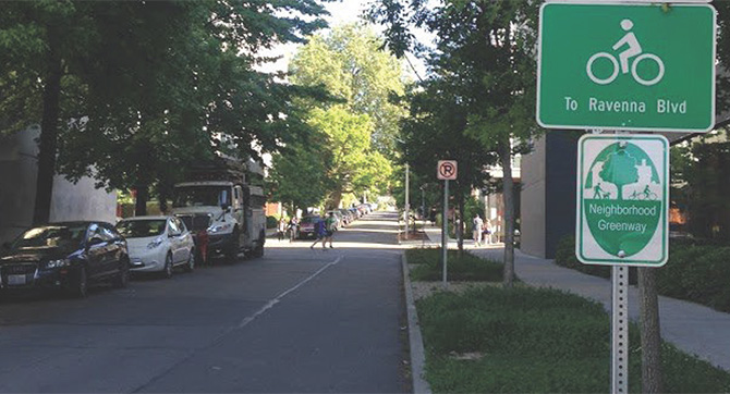 A sign indicates a street as a Neighborhood Greenway.